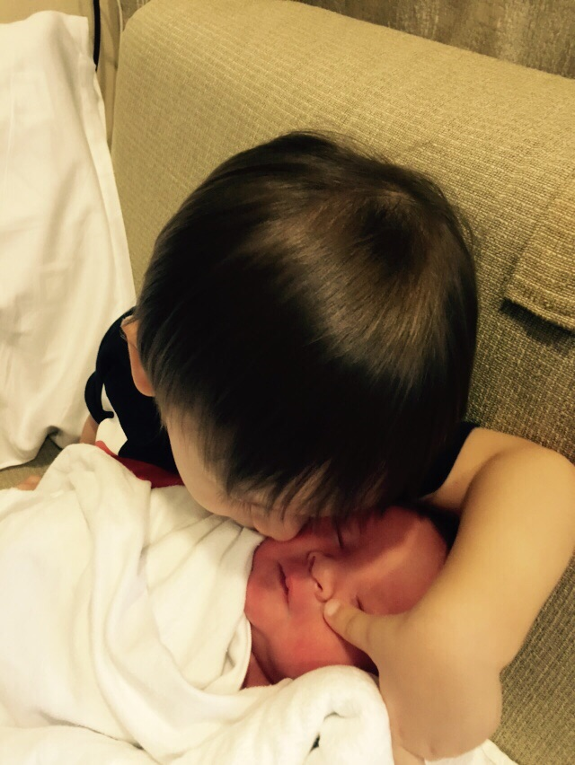 Charles giving Mikhail his first brotherly kiss!